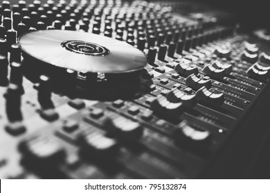 compact disc on sound mixer, black and white film. music background