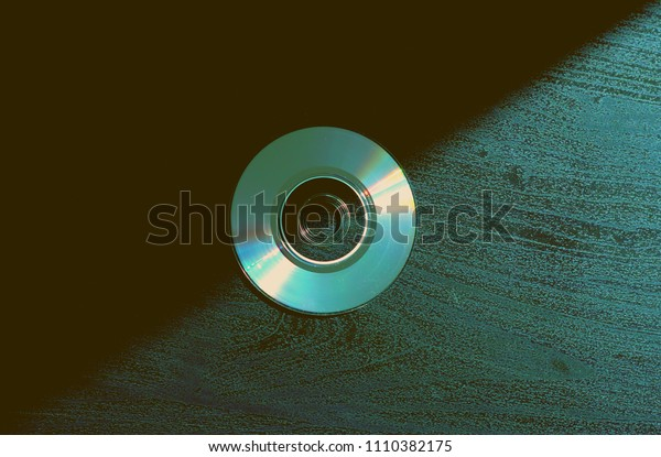 Compact discs on the background artistic future CD DVD colorful media film music sound technology time generation vintage minimal background wallpaper texture closeup 80s 90s 2000th years