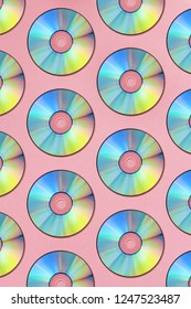 Compact discs on a pink background
