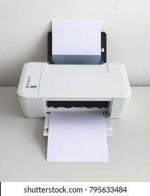 Compact home printer on a white desk