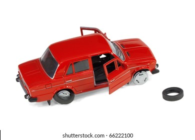 Compact model of a defective vehicle on a white background