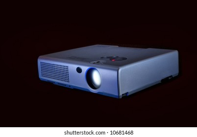 Compact  projector  for  video  on black  background  for  next  design