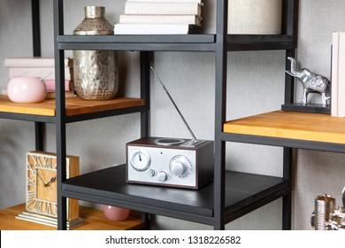 Compact radio on bookshelf in vintage living room interior