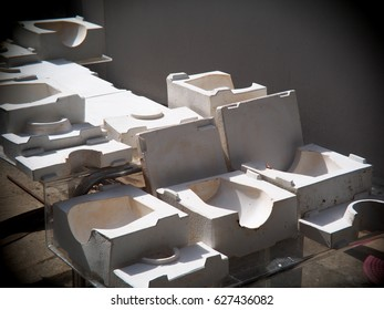 compact size pflaster, plaster mould for ceramic slip casting production process made by students dried under sunlight in a demonstration factory of an industrial design school