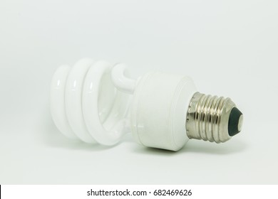 compact spiral fluorescent lamp light in white background