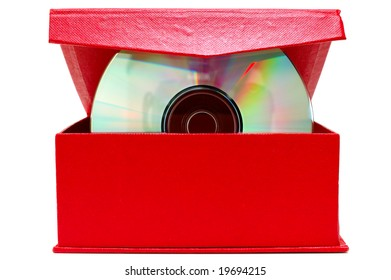 Compact-disk (CD or DVD) and red cardboard box on isolated background.