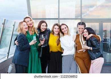 Company of beautiful young stylish women friends met together celebrating birghtday party in an expensive modern restaurant. People, friendship, communion, lifestyle