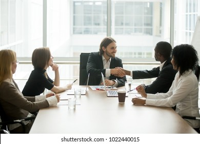 Company boss handshaking african american worker at corporate group meeting, ceo welcoming new hire, congratulating black employee with promotion, appreciating for good work result by shaking hands