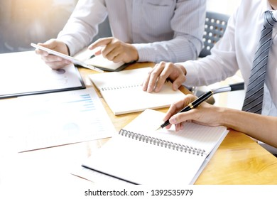 in company businessman in business  meeting analyses chart graphy marketing plan in business project