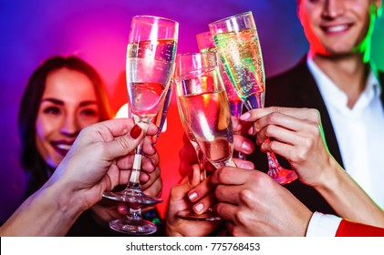 The company of cheerful young people with glasses of champagne at a party. Festive concept. Parties.