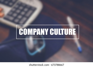 company culture with blurring business office background