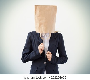 Company employee with paper bag over her head