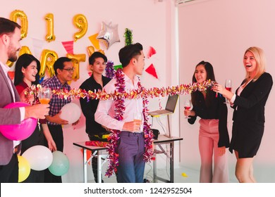 Company Employees Play limbo rock in a party to celebrate the New Year 2019 and a DJ at parties. Concept Happy New Year.