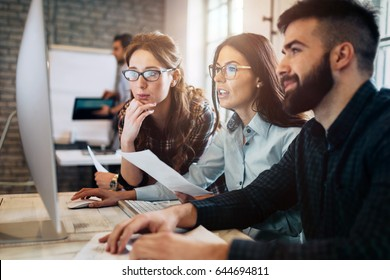 Company employees working in software development and designer office