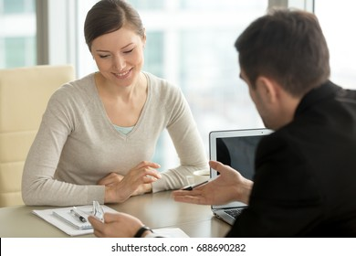 Company executive coaching young personal secretary assistant, team leader or senior manager explaining work duties to junior, businessman telling contractual terms or deal details to female partner
