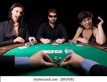 Company of friends having fun in the casino poker table