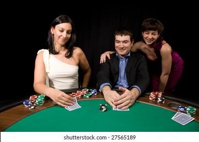 Company of friends having fun in the Vegas casino