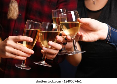 Company with glasses of champagne.  Concept New Year.