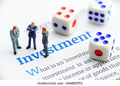 Company leaders stand and share or exchange opinion to each other about company investment project. In finance, benefit from investment is called a return i.e capital gain, income, dividends, interest