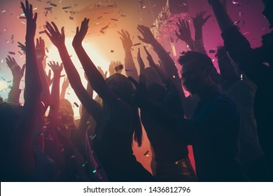 Company of nice attractive cheerful cheery positive carefree careless guys ladies gathering having fun vacation hanging out best summer corporate event at new cool dark modern place