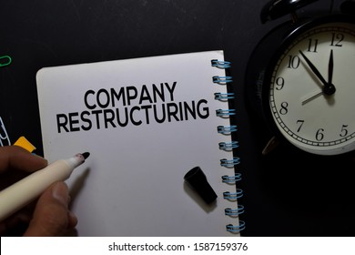 Company Restructuring write on book isolated on office desk.