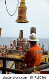 Company site representative monitors pile installation activities fro brand new offshore platform.