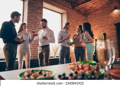 Company of six nice trendy attractive pretty elegant cheerful glad positive caucasian guys ladies pairs pal having fun luncheon brunch best tradition table buffet snack in industrial loft room