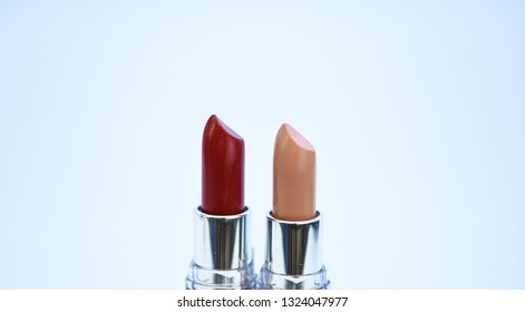 Compare makeup products. Lip care concept. Lipsticks on white background. High quality lipstick. Daily make up. Cosmetics artistry. Lipstick for professional make up. Pick color which suits you.