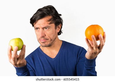 Comparing apples and oranges, a conceptual shot on a traditional saying