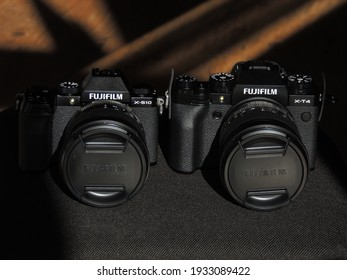 Comparison of Fujifilm X-T4 and X-S10 black cameras. The best cameras for videographers. Light background. Brand.