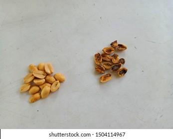 comparison of the good and bad roasted peanut. Aflatoxin in peanut. peanut fungi, contaminated food, discolored peanut.