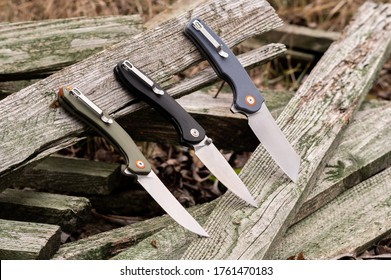 Comparison of several knives. Several knives in a row. Showcase of knives.
