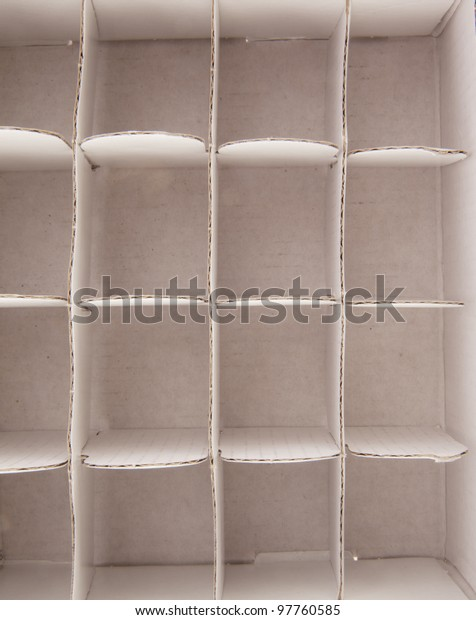 compartments in the form of partitions in a cardboard box