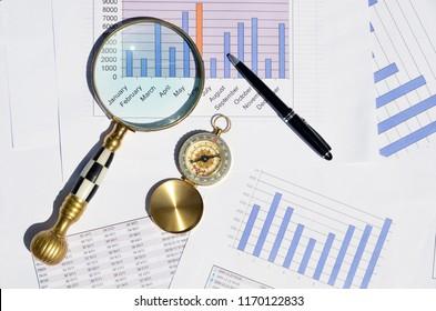 Compas on a market report