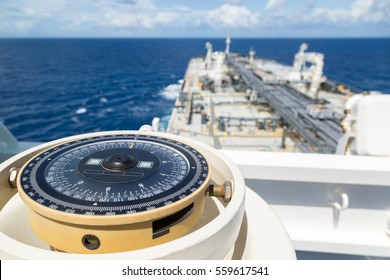 Compass aboard a ship on a blue summer sea.
