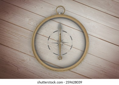 Compass against wooden floor