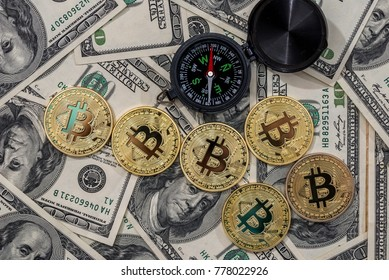 compass with bitcoin over dollar bills.