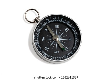 Compass with a black dial isolate on a white background. Traditional navigation device indicating the cardinal points (north, south, east, and west).