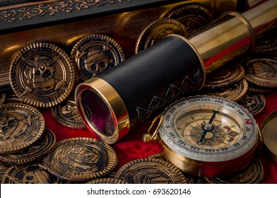 compass, book and scattered coins on old red velvet
