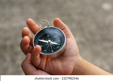 Compass in child hand