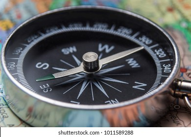 Compass close up on map of world