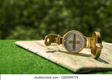 Compass, geographical map on the background of vegetation. travel, tourism.