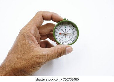 compass in hand on white background