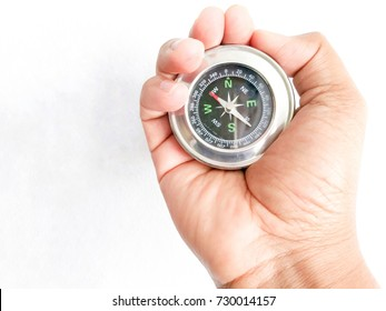 Compass in hand over white wall , guide for stalemate concept.