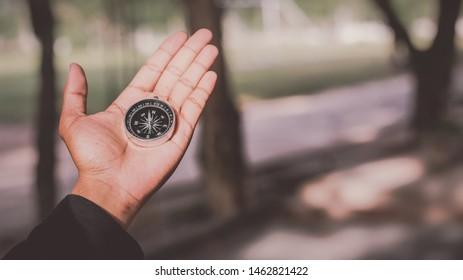 compass in hand and travel background, Guide texture.