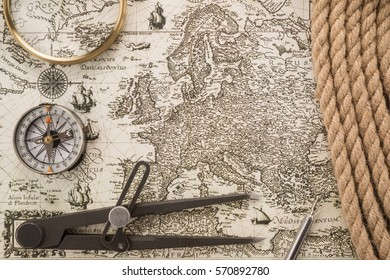 Compass, ink pen, magnifier, rope and instrument for measuring on vintage map