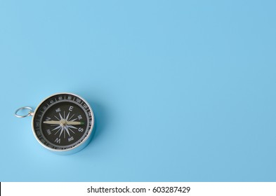 Compass isolated on a blue background