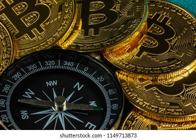 compass and many bitcoins