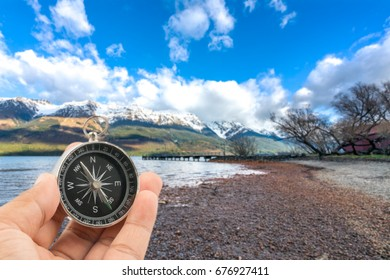Compass with natural blur background. Travel concept