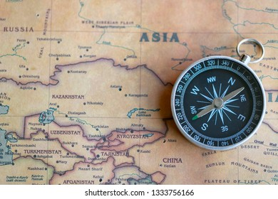 Compass on Asia part of world map. Travel to Asia concept.